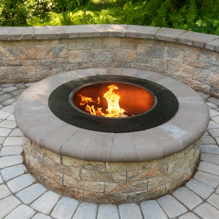 concrete walkway with lit firepit