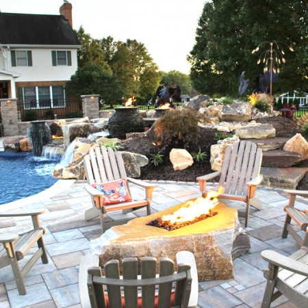 fire boulder and poolside patio with waterfall