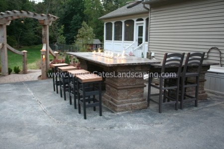 An Outdoor Fire Table installed by Willow Gates Landscaping