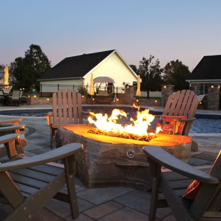 poolside patio with fire boulder side view
