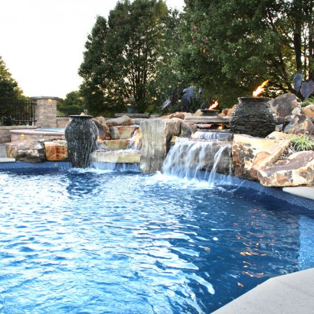 poolside patio with waterfall and rocks