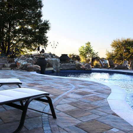 poolside patio with waterfall and fire boulder
