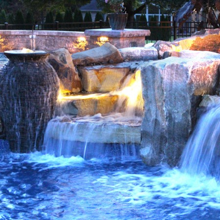 close up of the poolside patio with waterfall