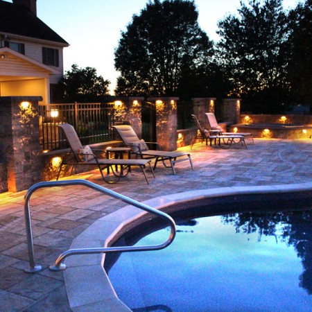 poolside patio with waterfall entrance