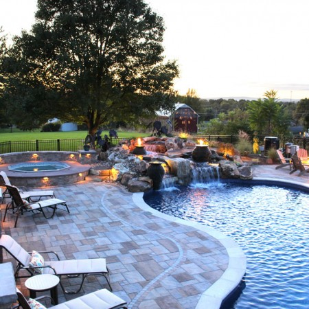 poolside patio with waterfall spa and fire boulder